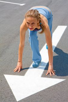 Athletic Woman In Start Position On Track Stock Photography