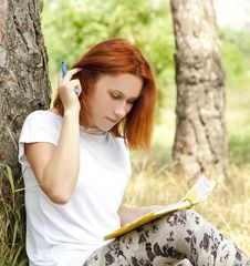Free Girl Doing Homework At Outdoor. Stock Images - 20196434