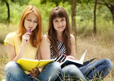 Girlfriends Doing Homework At The Park. Royalty Free Stock Photos