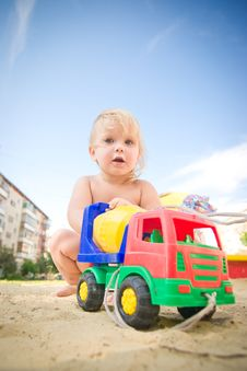 Free Adorable Baby Play With Toy Concrete Mixer Truck Royalty Free Stock Photography - 20199197
