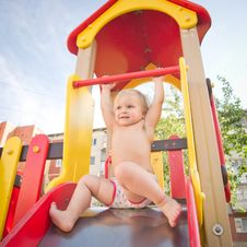 Free Young Adorable Baby Sliding Down Baby Slide Stock Photos - 20199203