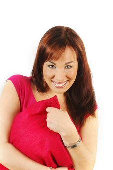 Free Smiling  Brunette In A Red Top Hugging A Cushion Royalty Free Stock Image - 2020076