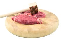 Free Steaks On A Chopping Board With Mallet Royalty Free Stock Images - 2021819