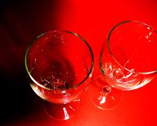 Free Pair Of Wine Glasses Against Red Background Royalty Free Stock Images - 2023519