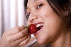 Free Woman Eating Strawberry Stock Image - 2026221