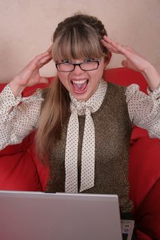 Free Amazed Woman In Glasses With Laptop Stock Photo - 2027000