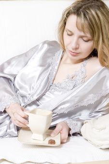 Leaning On The Sofa Enjoying A Coffee Royalty Free Stock Photos
