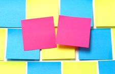Free Pink Sticky Notes On Blue And Yellow Royalty Free Stock Image - 2028396