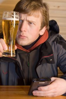 Free Man Looking At Beaker Of Beer Stock Photos - 2028403