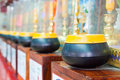 Free Row Of Monk S Alms Bowls Royalty Free Stock Photos - 20201808