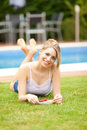 Free Young Woman Eating A Cherries On The Grass Stock Images - 20207214