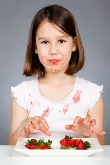 Free Little Girl Eating Strawberries Stock Image - 20204701