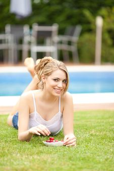 Free Young Woman Eating A Cherries On The Grass Stock Photo - 20207210