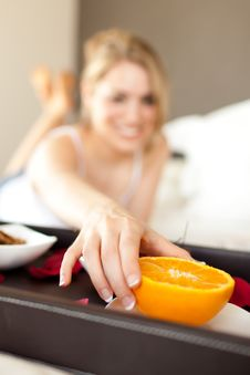 Young Woman Picking An Orange For Breakfast Stock Images