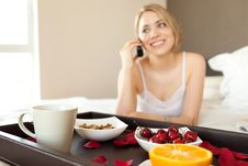 Woman Having A Healthy Breakfast, Fruits, Coffee Royalty Free Stock Photos