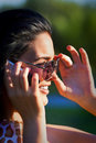 Free Woman Wearing Sunglasses  Talking On Mobile Phone Stock Photo - 20225080