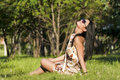 Free Beautiful Brunette Sitting On The Grass Stock Photography - 20226192