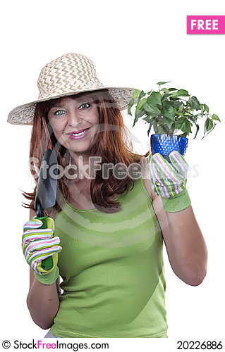 Free Redhead Woman Working In The Garden Royalty Free Stock Image - 20226886
