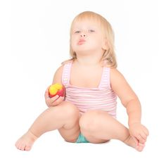 Free Adorable Girl Eat Red Fresh Peach Sitting On White Royalty Free Stock Photography - 20224597