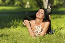 Free Young Beautiful Brunette Lying On The Grass Royalty Free Stock Photography - 20226117