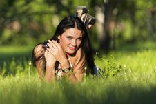 Free Young Beautiful Brunette Lying On The Grass Royalty Free Stock Photo - 20226135