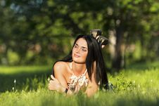 Free Young Beautiful Brunette Lying On The Grass Royalty Free Stock Photography - 20226157