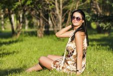 Free Beautiful Brunette Sitting On The Grass Stock Images - 20226174