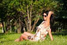 Free Beautiful Brunette Sitting On The Grass Royalty Free Stock Photography - 20226217