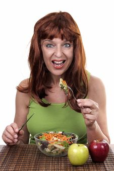 Free Redhead Woman Eating Royalty Free Stock Photography - 20226947
