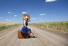 Free Lonely Girl With Suitcase At Country Road. Royalty Free Stock Photos - 20228148