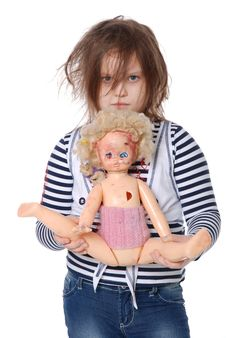 The Girl And A Doll Stock Photos