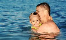 Dad And Daughter Swimming In The Sea Stock Image