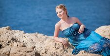 Pretty Woman On The Rocky Mountain Near The Sea Royalty Free Stock Photo