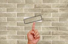 Free Hand Pointing On Brick Wall Stock Photos - 20234443