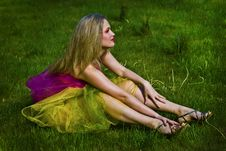 Free Happy Young Woman Sitting On Grass Royalty Free Stock Images - 20236729