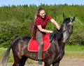 Free A Girl With Her Hair Stroking Horse Stock Image - 20241681