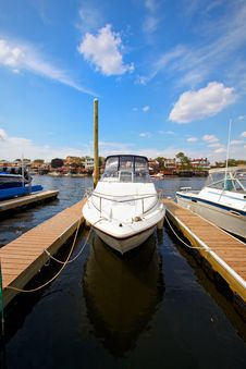 Motor Boat Docked In The Marina. Royalty Free Stock Image
