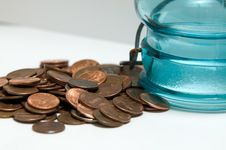 Free Coins From A Coin Bank Stock Photos - 20241303