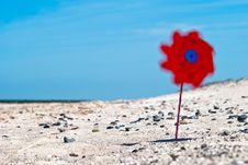 Free Red Wind Turbine On The Beach Royalty Free Stock Photos - 20242838
