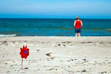 Free Red Wind Turbine On The Beach Royalty Free Stock Image - 20242866