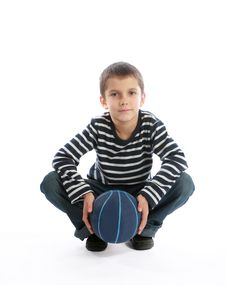 Free Boy Holding A Ball Stock Photos - 20243283