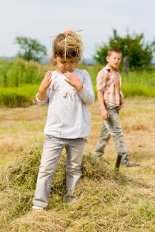 Free The Girl Costs On Hay Stock Photos - 20243303