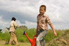 Free The Boy And Watering Can Royalty Free Stock Image - 20243396