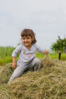 Free Girl On The Hay Stock Photos - 20243553