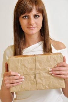 Free Girl With A Package Stock Image - 20244701