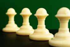 Free Shows Four Pawns On A Green Background Stock Photo - 20246300