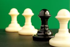 Shows Four Pawns On A Green Background Stock Photo