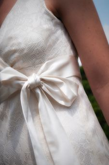 Free Brides Dress With Bow From Front Close Up Stock Photos - 20246743