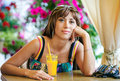 Free Woman Drinking Orange Juice In Cafe Stock Images - 20251784