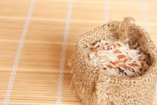 Free Raw Rice In Woven Bag Stock Photo - 20252370